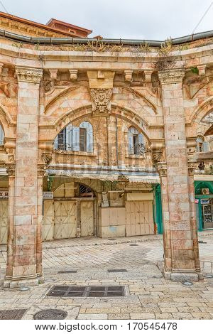 JERUSALEM, ISRAEL - MAY 24, 2016: Historic architecture of the old city bazaar Bazaar very popular site for tourists and pilgrims.