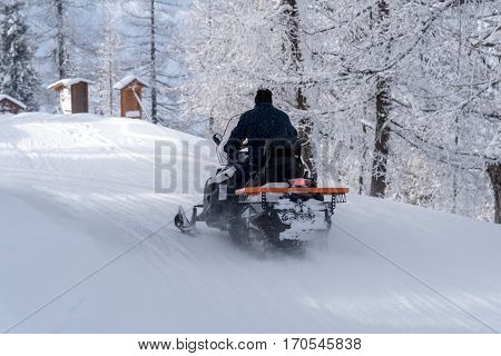 The scooter moving on the frozen road in the mountains