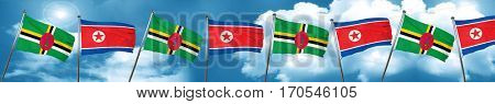 Dominica flag with North Korea flag, 3D rendering