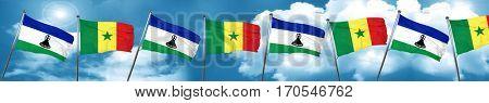 Lesotho flag with Senegal flag, 3D rendering
