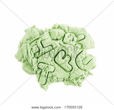 Pile of kinetic sand with the letter marks over it, composition isolated over the white background