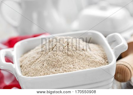 Wholemeal flour on wooden rustic table, cooking in kitchen