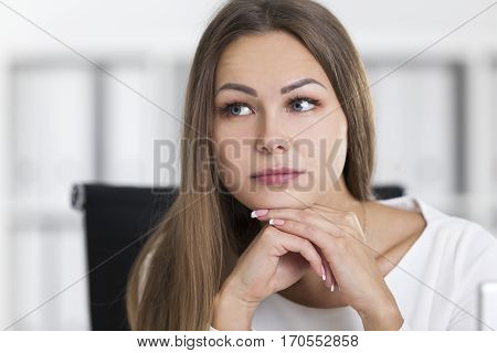 Close Up Of Pensive Blond Woman In White In Office