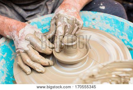 Man hands creating ceramics at a festival