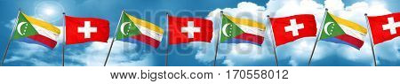 Comoros flag with Switzerland flag, 3D rendering