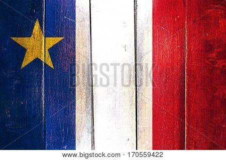 Vintage Acadia flag on grunge wooden panel