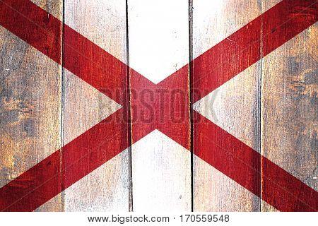Vintage alabama flag on grunge wooden panel