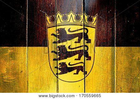 Vintage Baden Wurttemberg flag on grunge wooden panel