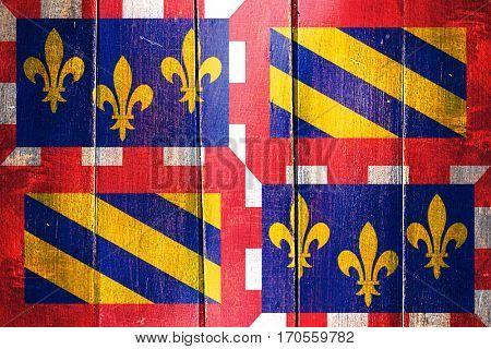 Vintage bourgogne flag on grunge wooden panel