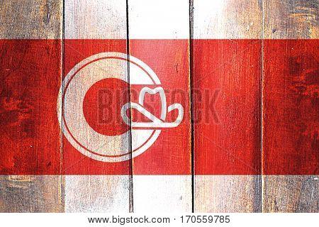 Vintage Calgary flag on grunge wooden panel