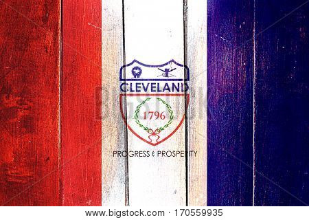 Vintage Cleveland flag on grunge wooden panel
