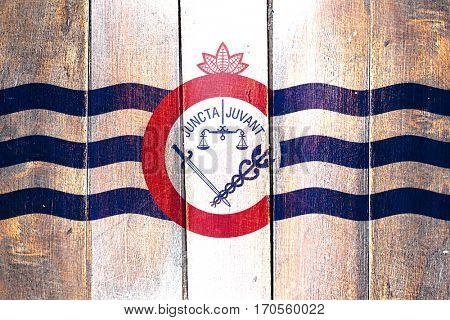 Vintage Cincinnati flag on grunge wooden panel