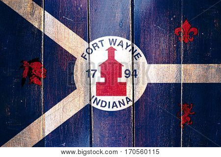 Vintage Fort wayne flag on grunge wooden panel
