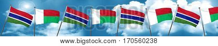 Gambia flag with Madagascar flag, 3D rendering