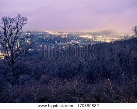 Early evening scene of city lights in the distance from Skyline Drive in Virginia