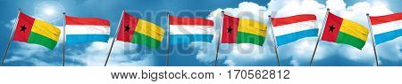 Guinea bissau flag with Luxembourg flag, 3D rendering