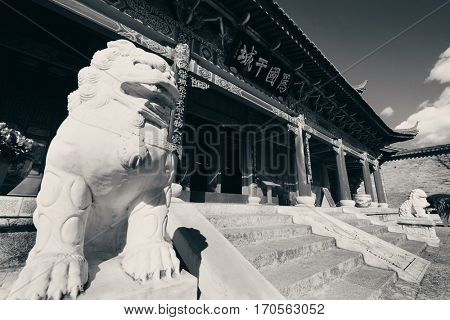 Mu Family Residence building with lion statue in Lijiang, Yunnan, China.