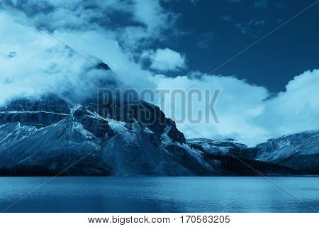 Snow Mountain with fog and lake forest