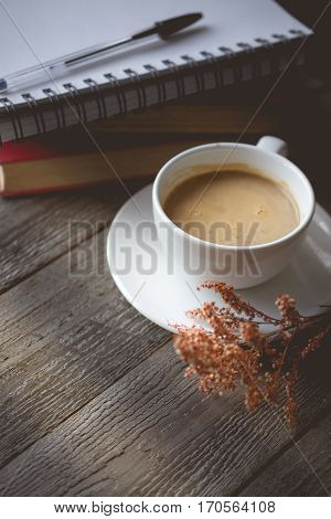 Chill and Relax with Hot Coffee and Note Book on old wooden in vintage color tone used for food ad or website promote. beverage for people to work place