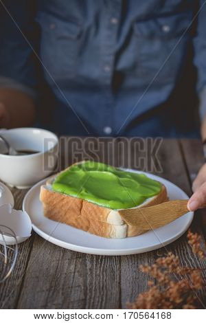 break time coffee time with pandan custard cream on toasted easy and ready to eat breakfast in morning with bread and custard cream topping