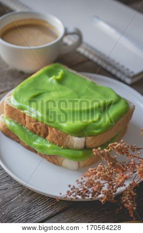 break time coffee time with pandan custard cream on toasted easy breakfast in morning with bread and custard cream topping