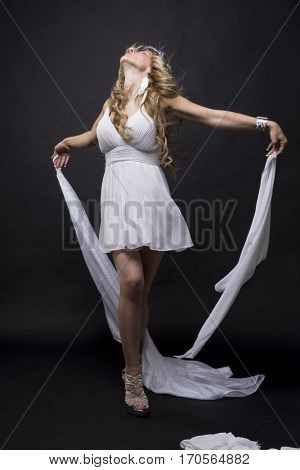 Luxury, Beautiful greek blonde woman, mythology, dressed in white silk dress and laurel wreath handmade with silver