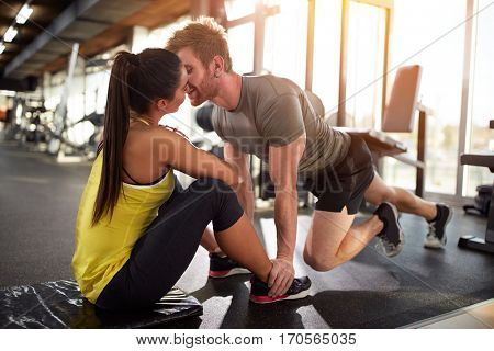Male and female with close face on training in gym