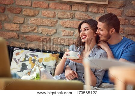 Cheerful male and female in love in cafeteria