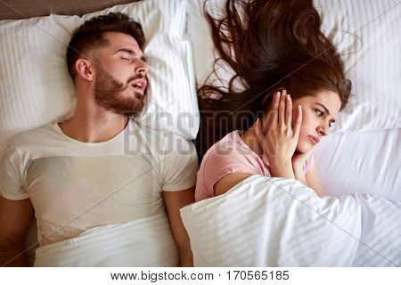 Young couple have problem with man's snoring