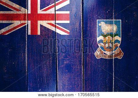 Vintage Falkland islands flag on grunge wooden panel