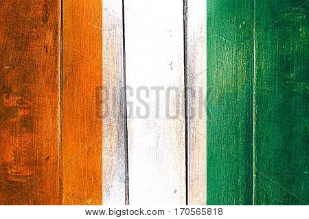 Vintage Ivory coast  flag on grunge wooden panel
