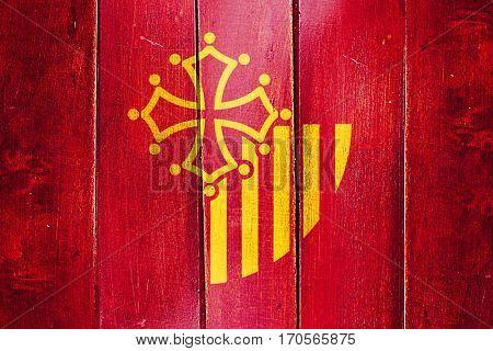 Vintage Languedoc rousillon flag on grunge wooden panel