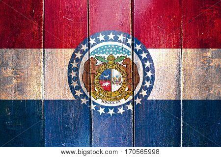 Vintage missouri flag on grunge wooden panel