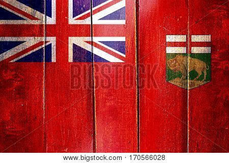 Vintage Manitoba flag on grunge wooden panel