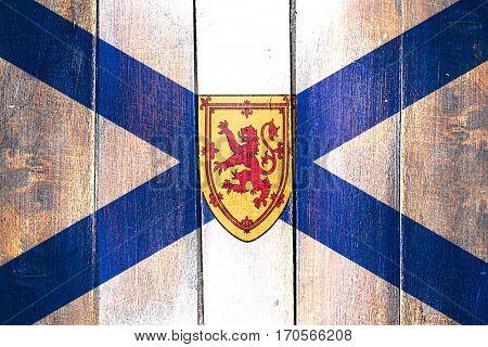 Vintage Nova scotia flag on grunge wooden panel