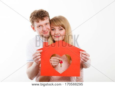 Happy Pair Holding Symbols.