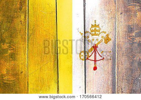 Vintage papal state flag on grunge wooden panel
