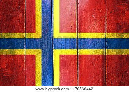 Vintage Orkney flag on grunge wooden panel