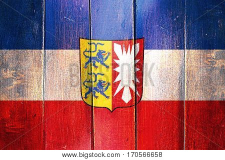 Vintage schleswig holstein flag on grunge wooden panel