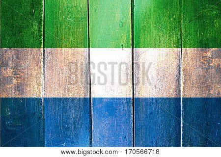 Vintage Sierra Leone  flag on grunge wooden panel