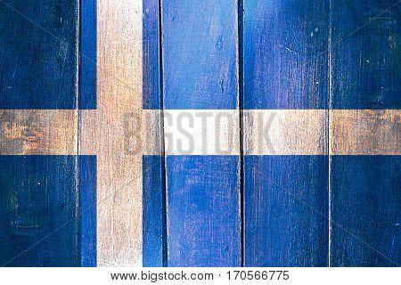 Vintage Shetland flag on grunge wooden panel