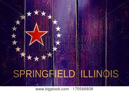 Vintage Springfield flag on grunge wooden panel