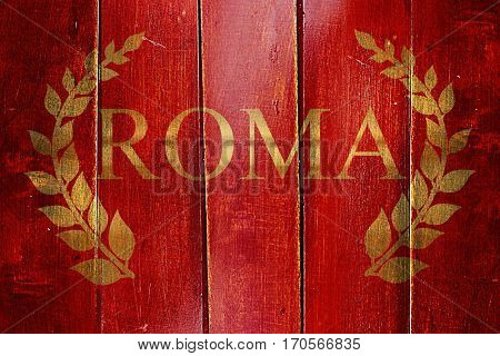 Vintage Roman empire flag on grunge wooden panel