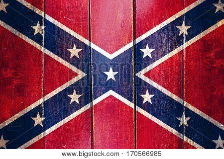 Vintage Rebel symbol flag on grunge wooden panel