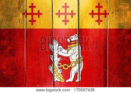 Vintage Warwickshire flag on grunge wooden panel