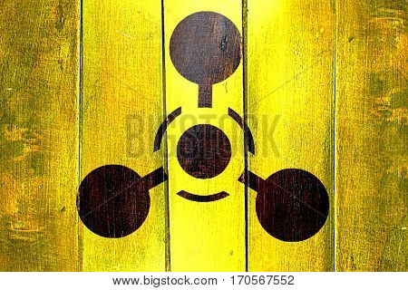 Vintage Chemical weapon sign on a grunge wooden panel