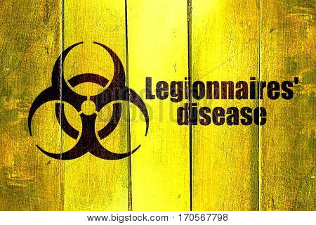 Vintage Legionnaires disease on a grunge wooden panel