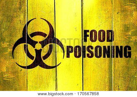 Vintage Food poisoning on a grunge wooden panel