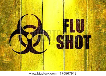Vintage Flu shot on a grunge wooden panel