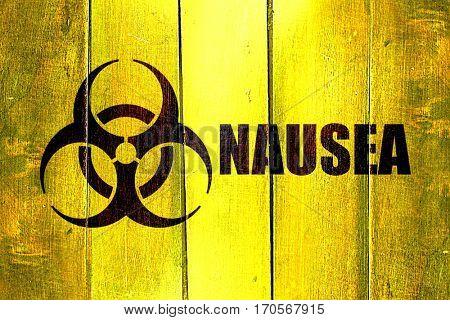 Vintage Nausea on a grunge wooden panel